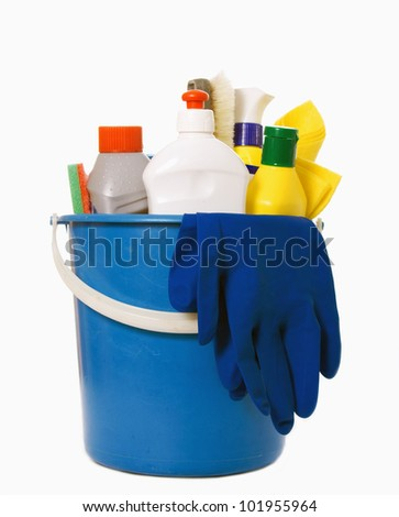 detergent bottles, brushes, gloves and sponges in bucket isolated on white