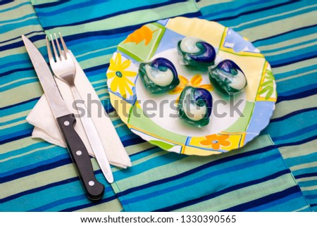 Detergent pods in a plate as concept to the tide pod challenge #1330390565