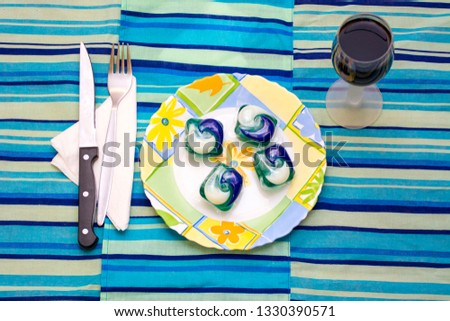 Detergent pods in a plate as concept to the tide pod challenge #1330390571