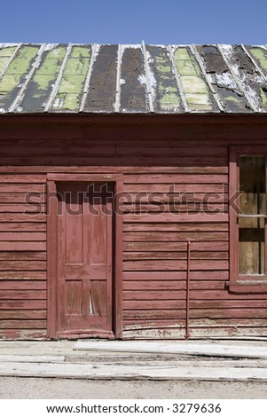 Deteriorated Building with a Rusted Roof and Boarded Windows
