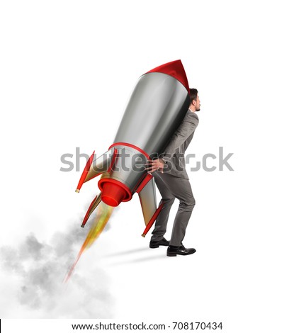 Determination and power businessman that holds a rocket isolated on white background - Shutterstock ID 708170434
