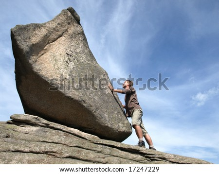 Determination - young man against the rock.