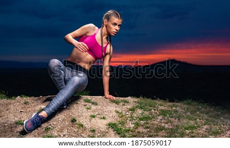 Determined Athletic Fitness Woman Stretching on Hills at Sunset, Mixed Martial Arts, MMA, Tae Bo