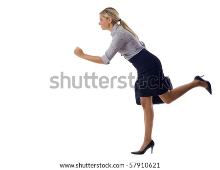 Determined business woman holding suitcase and running on isolated white background