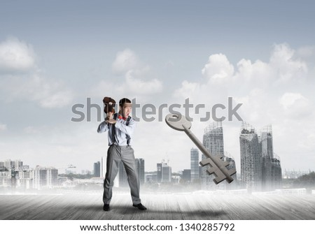 Determined businessman against modern cityscape breaking with violin stone key figure #1340285792