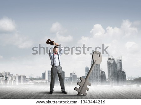 Determined businessman against modern cityscape breaking with violin stone key figure #1343444216
