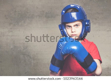 Determined little boy ready to fight #1023963166