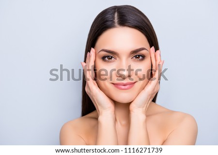 Detox botox collagen vitamins minerals treatment therapy concept. Gorgeous aesthetic woman with natural makeup enjoying her flawless perfect skin after laser procedure isolated on grey background