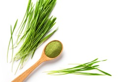 Detox Food Superfood Isolated Green Barley Sprout grass and a Spoonful of Powder, Flat Lay. Space for Text on the white.