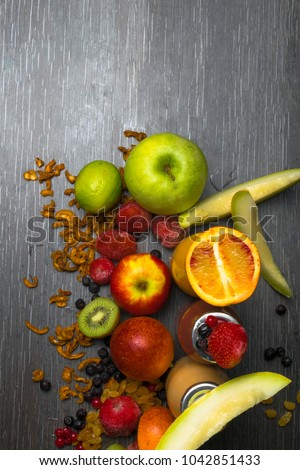 Detox. Fresh juice and smoothies with berries, cidonia, fruits, raisins, coconut oil - Shutterstock ID 1042851433