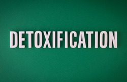 Detoxification lettering sign made with colorful background and white ceramic letters.