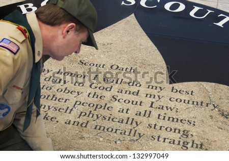 DETROIT - FEB 8,2013: Joe Parton Scoutmaster overlooks BSA Scout Oath on the floor of Dauch Scout Center in Detroit.