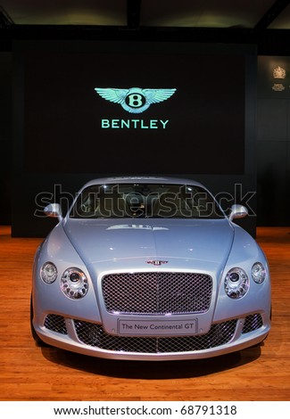 DETROIT - JANUARY 10: 2011 Bentley Continental GT on display at the 2011 North American International Auto Show Press Preview on January 10, 2011 in Detroit, Michigan. - stock photo