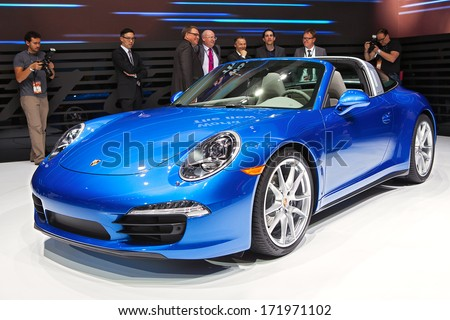 DETROIT - JANUARY 13 : Members of the media examine the new Porsche 911 Targa at the North American International Auto Show media preview  January 13, 2014 in Detroit, Michigan.