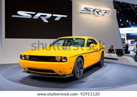 DETROIT - JANUARY 11: The Dodge Challenger SRT at the 2012 North American International Auto Show Industry Preview on January 11, 2012 in Detroit, Michigan. - stock photo