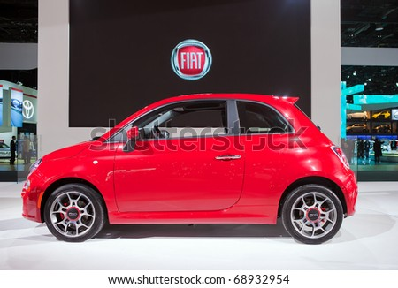 DETROIT - JANUARY 11: The 2012 Fiat 500 at the 2011 North American International Auto Show Press Preview on January 11, 2011 in Detroit, Michigan. - stock photo