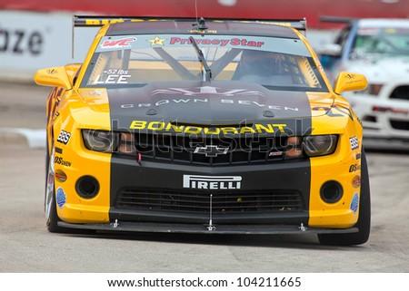 DETROIT - JUNE 2: The Chevey Camaro SS races at the 2012 Detroit Grand Prix on June 2, 2012 in Detroit, Michigan.