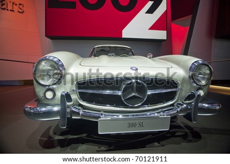 DETROIT, MICHIGAN - JANUARY 18: A new 300 SL Mercedes Benz is on display at the 2011 North American International Auto Show on January 18, 2011 in Detroit, Michigan. - stock photo