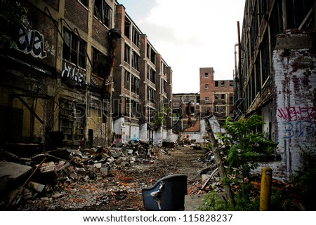 DETROIT, MICHIGAN - NOV 21: Abandoned Packard factory ruins on a sunny afternoon on November 21, 2012. Abandoned in 1958, the buildings still stand in a decayed state of beauty. - stock photo