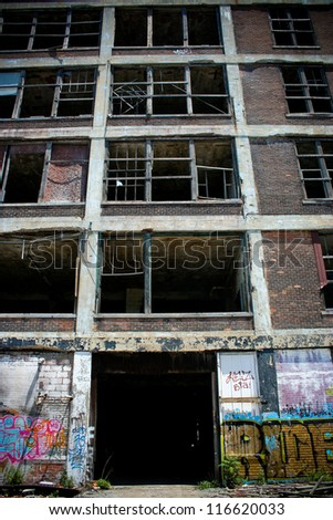 DETROIT, MICHIGAN - NOV 21: Abandoned Packard factory ruins on a sunny afternoon on November 21, 2012. Abandoned in 1958, the buildings still stand in a decayed state of beauty.