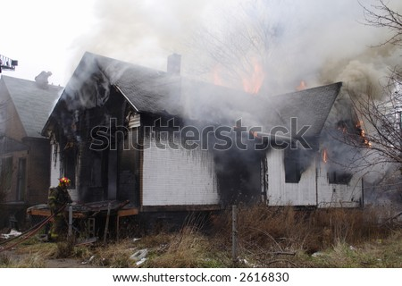 Detroit neighborhood house in flames and billowing smoke