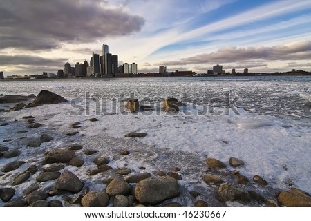 Detroit River still packed with ice blocks, seen from Windsor, ON. The dramatic sky of the nice but cold afternoon seems to converge all to Detroit downtown.