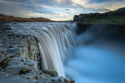 Dettifoss. Situated in Vatnajokull N.P. in Northeast Iceland, it's the most powerful waterfall in Europe. Photo taken from the east bank at sunset.