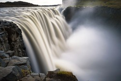 Dettifoss waterfall located on the Jokulsa a Fjollum river in Iceland. Dettifoss is the second most powerful waterfall in Europe after the Rhine Falls. Long exposure.