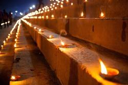 Dev Deepawali festival, Earthen lamps lit on the stairs leading to the Ganges, Varanasi, Uttar Pradesh, India.