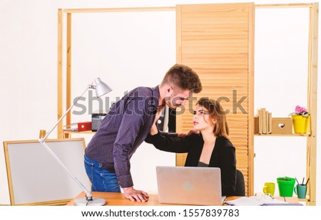 Developing a relationship. Sexual relationship with business partner. Boss and secretary having romantic relationship. Loving relationship between bearded man and sexy woman in office.