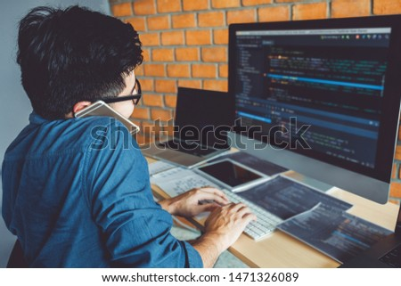 Developing programmer Development Website design and coding technologies working in software company office stock