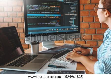 Developing programmer team reading computer codes Development Website design and coding technologies.