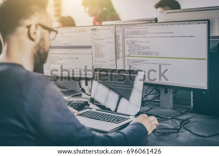 Developing programming and coding technologies. Website design. Programmer working in a software develop company office. - Shutterstock ID 696061426