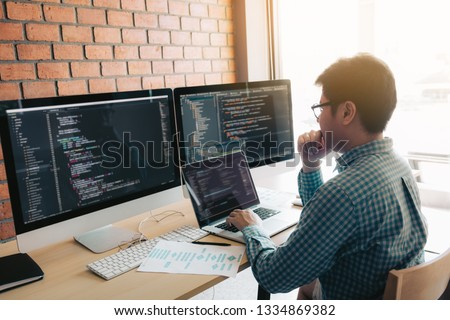 Developing programming and coding technology working in a software develop company office.