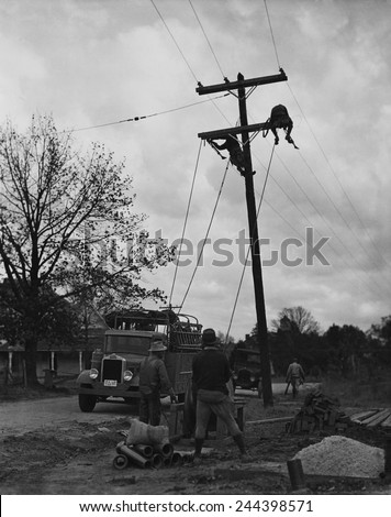 Developing TVA (Tennessee Valley Authority) electric transmission lines as part of Franklin Roosevelt\'s \'New Deal\' rural electrification.
