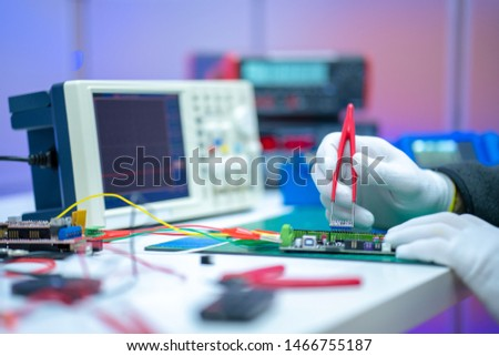 Development of electronic devices in the modern electronics laboratory, on a table, microprocessor oscilloscope and multimeter #1466755187