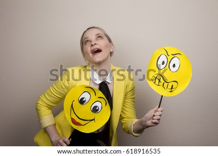 Development of emotional intelligence. The girl plays with smiles, builds faces. #618916535