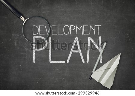 Development plan concept on black blackboard with empty paper sheet and coffee cup Сток-фото ©