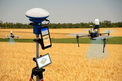 Device for measuring field area and positioning drones. Precision farming system