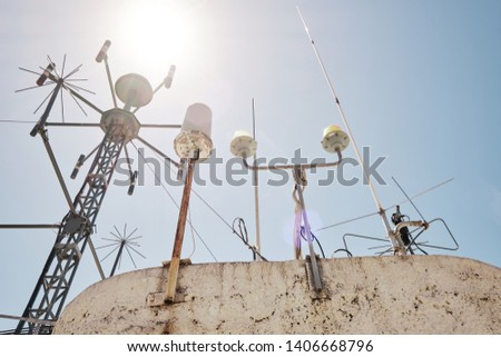 devices for meteorological observations on the roof of the building #1406668796