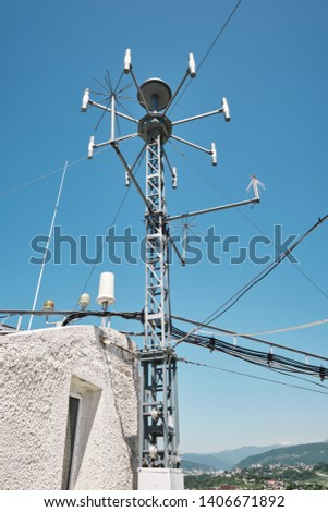 devices for meteorological observations on the roof of the building #1406671892