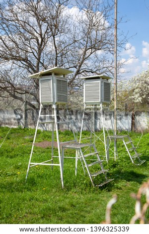 Devices of meteorological station on the blue sky. Place for meteorology with sunlight in good weather. #1396325339
