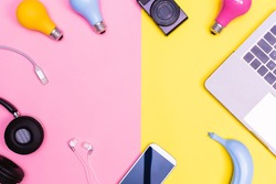 Devices with objects on a pink and yellow background