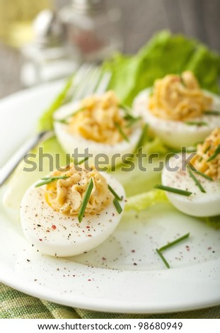 Devil eggs with lettuce in a plate