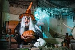 Devil in wicked witch hat. Happy Halloween. Horror with scary Halloween demon man. Design for Halloween banner. Vampire Halloween Concept