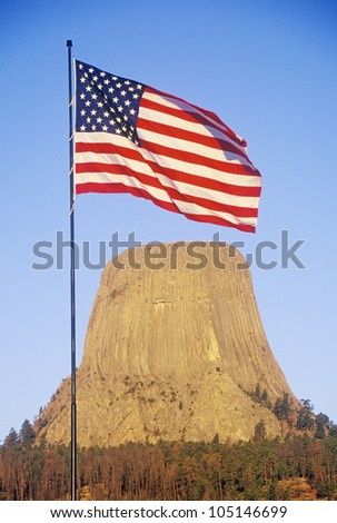 Devil's Tower National Monument and an American Flag, Wyoming