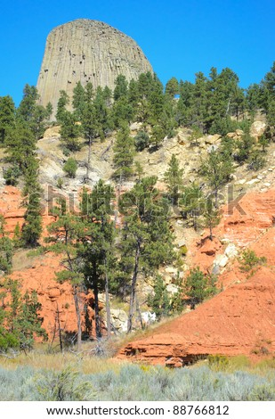 Devils Tower and red rock cliffs