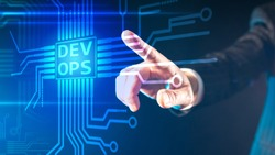 DevOps concept. A person puts their finger on a touch screen that says DevOps. The concept of flexible Devops software development. Interaction of technical specialists.