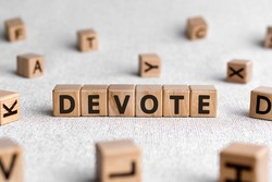 Devote - words from wooden blocks with letters, to give all of something devote concept, white background