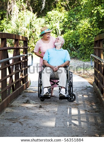 Devoted senior wife cares for her disabled husband.